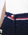 Short en tweed bleu à galons rouge Edward Achour