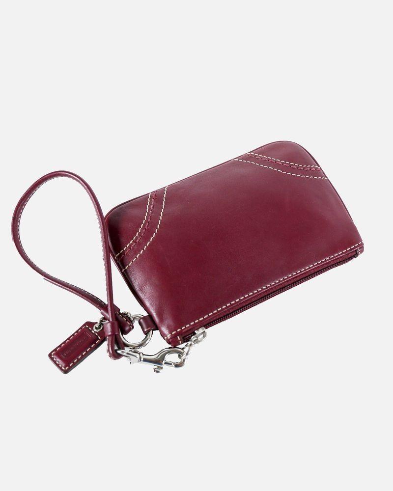 Porte monnaie en cuir bordeaux Coach