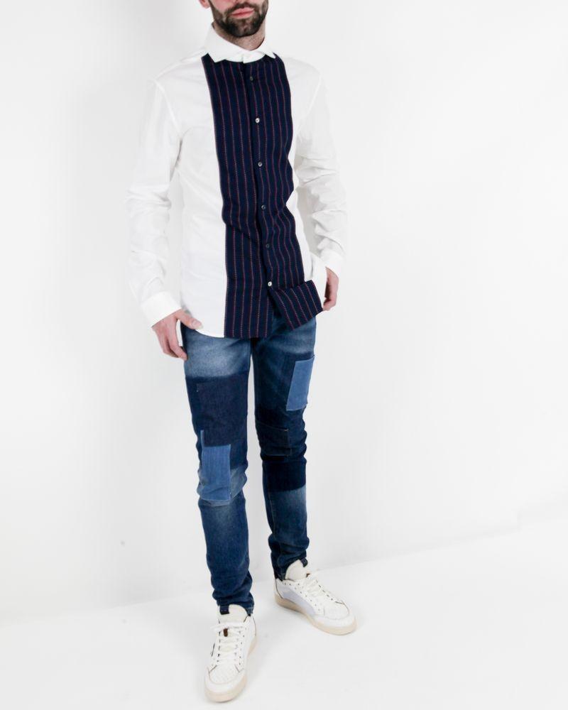 Jean skinny bleu à patchworks John Galliano