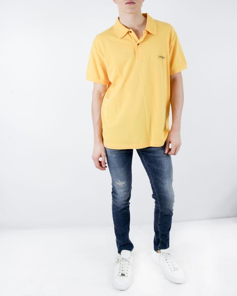Polo en coton piqué jaune à logo brodé JC De Castelbajac
