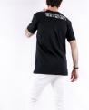 T shirt en coton noir à logo clouté John Richmond