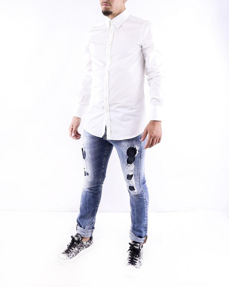 Jean skinny en coton bleu effet dechiré John Richmond