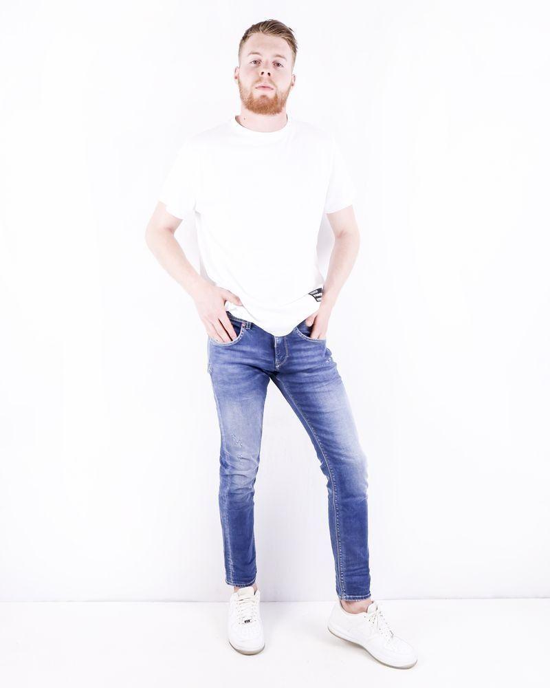 Jean slim en coton bleu délavé à déchirure 3D