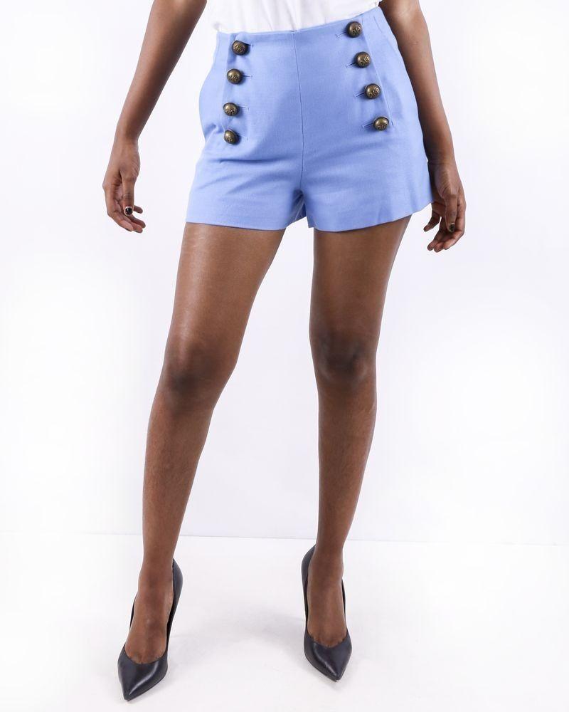 Short en coton piquée bleu à boutons griffés Maison Pere