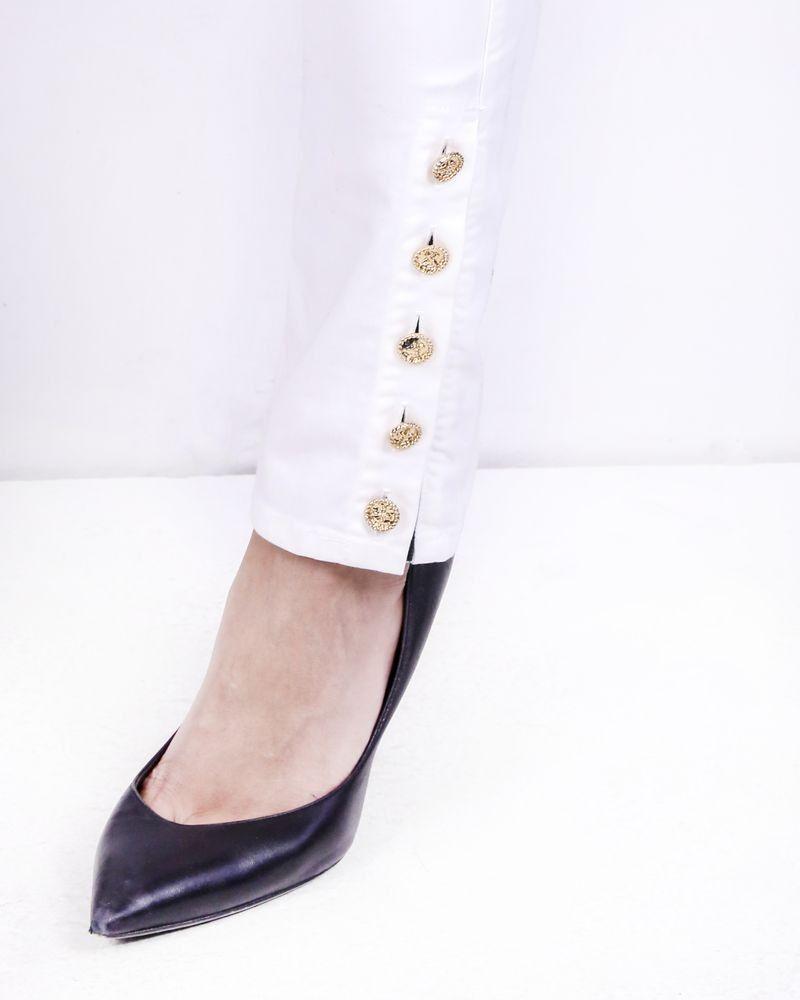 Pantalon skinny blanc à boutons fantaisies Edward Achour