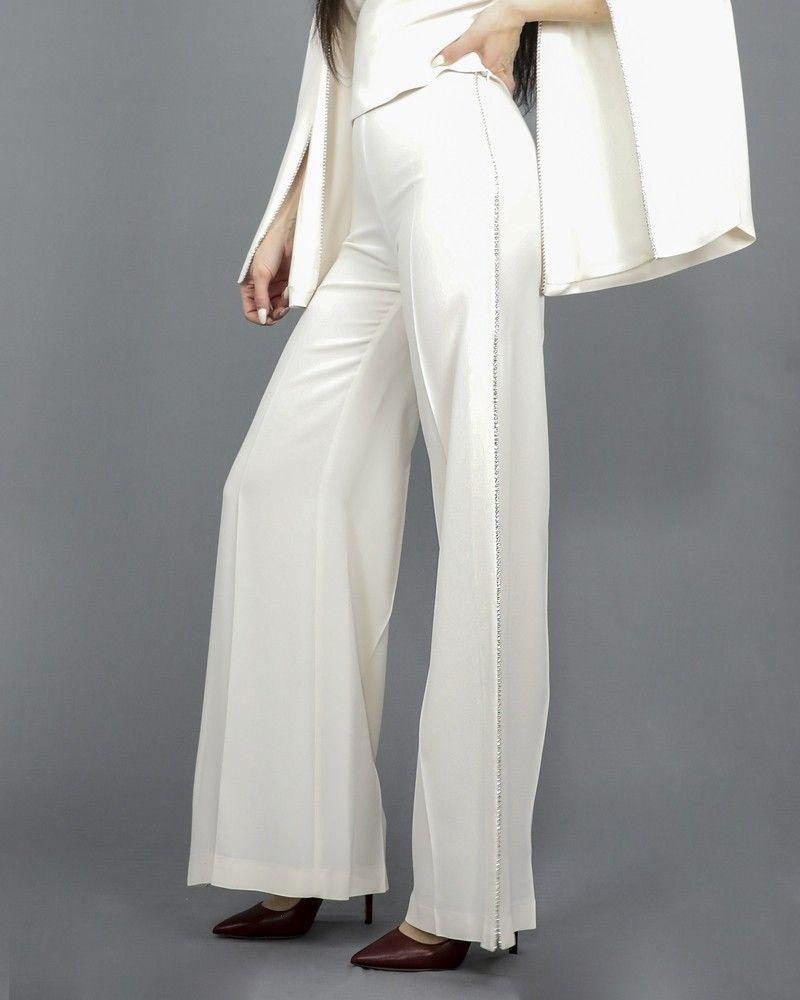Pantalon palazzo blanc fendue à galon strassé Space Simona Corsellini