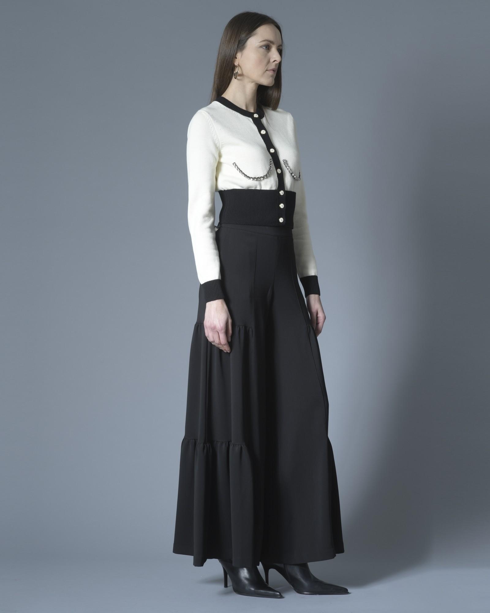 Gilet blanc et noir tricoté avec détail strass