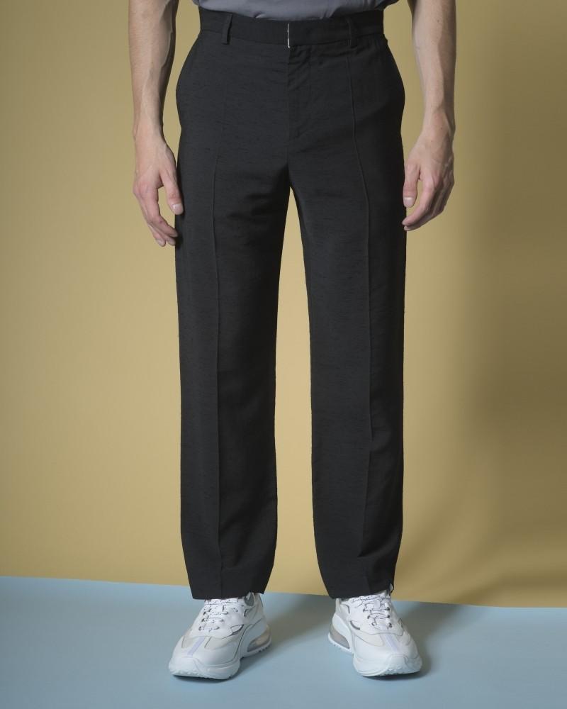 Pantalon texturé noir...