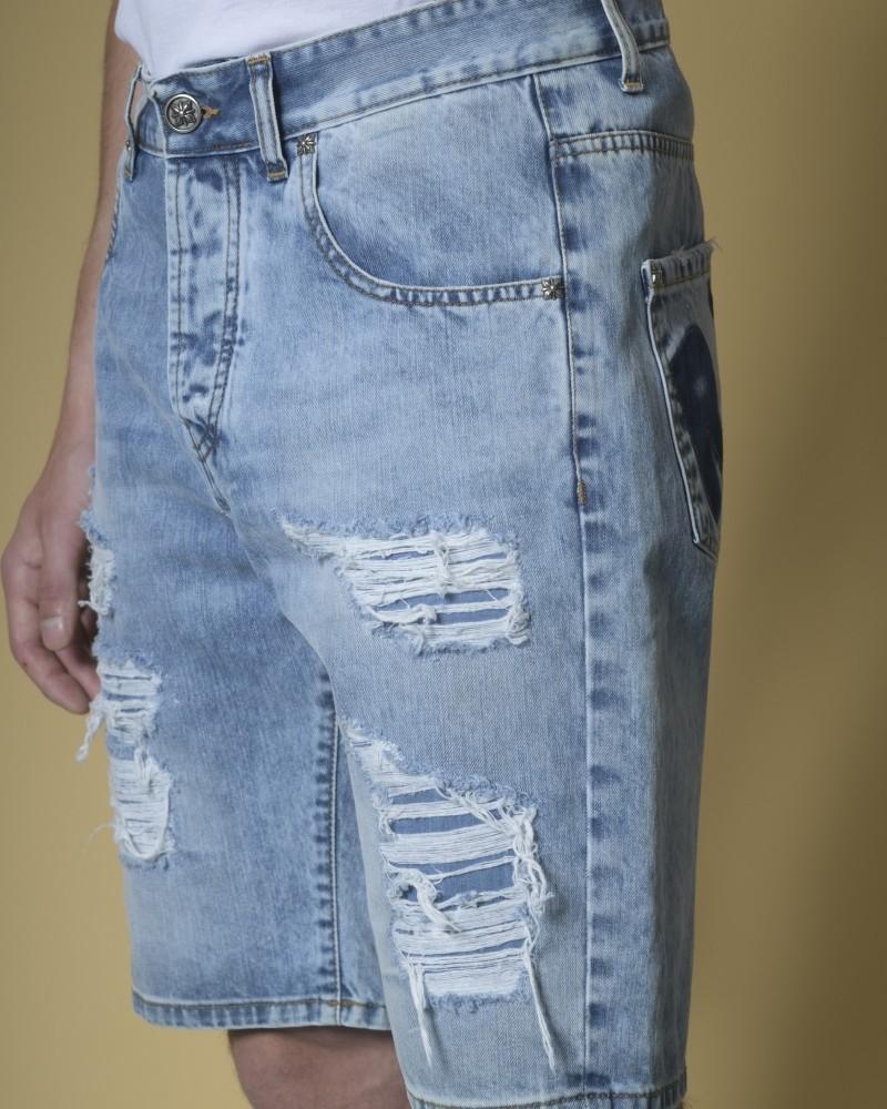 Short jean effet vieilli et empiècement en cuir John Richmond