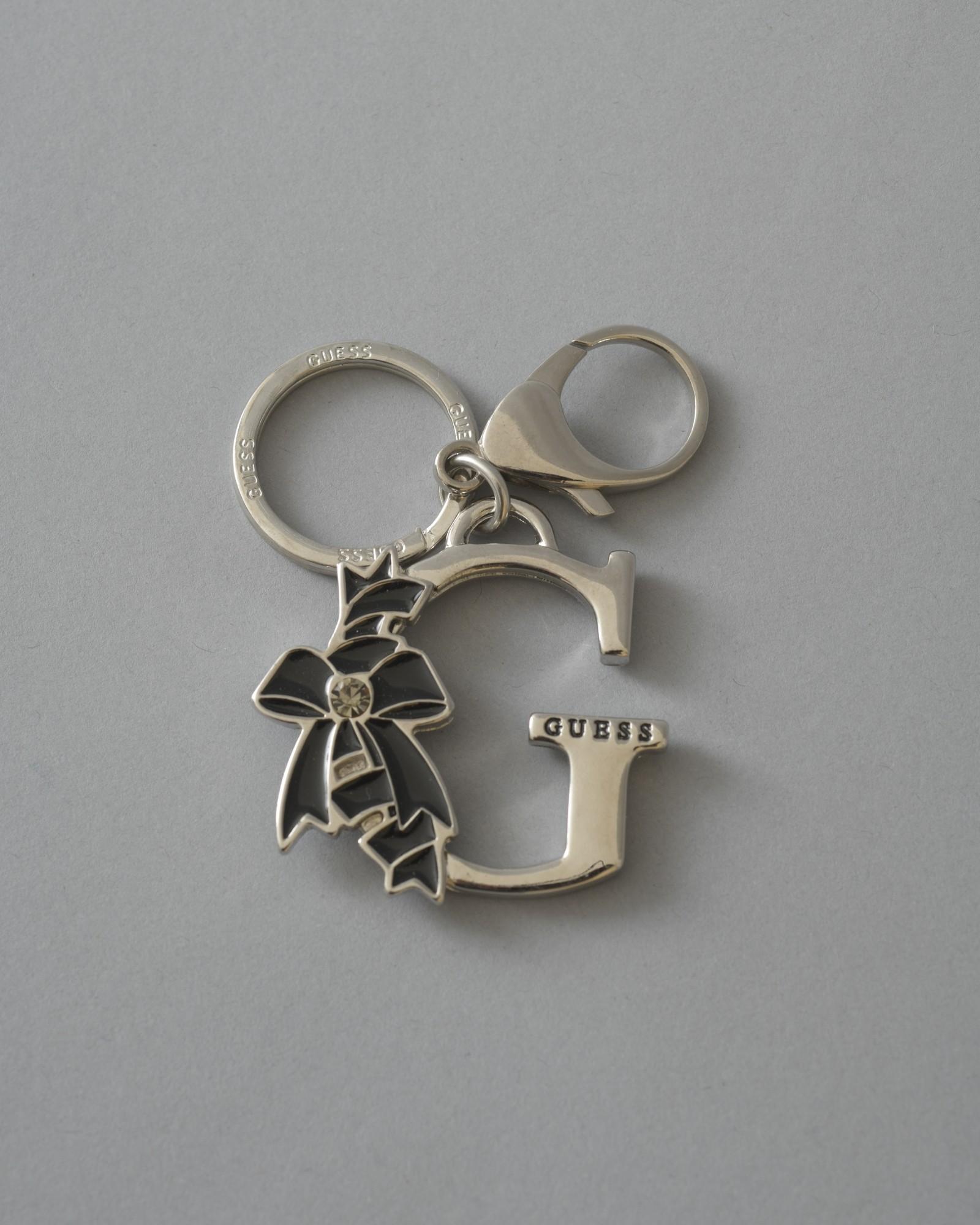 """Porte-clés """"G"""" à noeud Guess"""